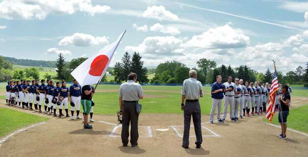 JapanOs Madonna Stars, left, and USA Baseball WomenOs National Team during the National Anthems at the opening game of the Cooperstown WomenOs Baseball Classic Friday July 10, 2015 at SUNY in Cobleskill, NY.   (John Carl D'Annibale / Times Union) Photo: John Carl D'Annibale / 00032552A