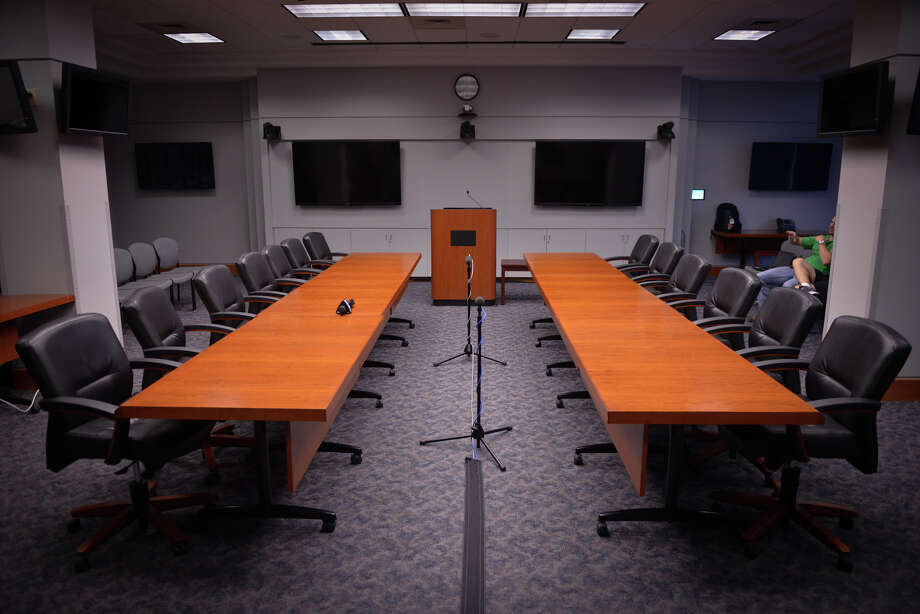 The negotiating tables await the negotiating teams from the city and the San Antonio Police Association as contract talks resumed Friday. Photo: Robin Jerstad, Freelance / San Antonio Express-News