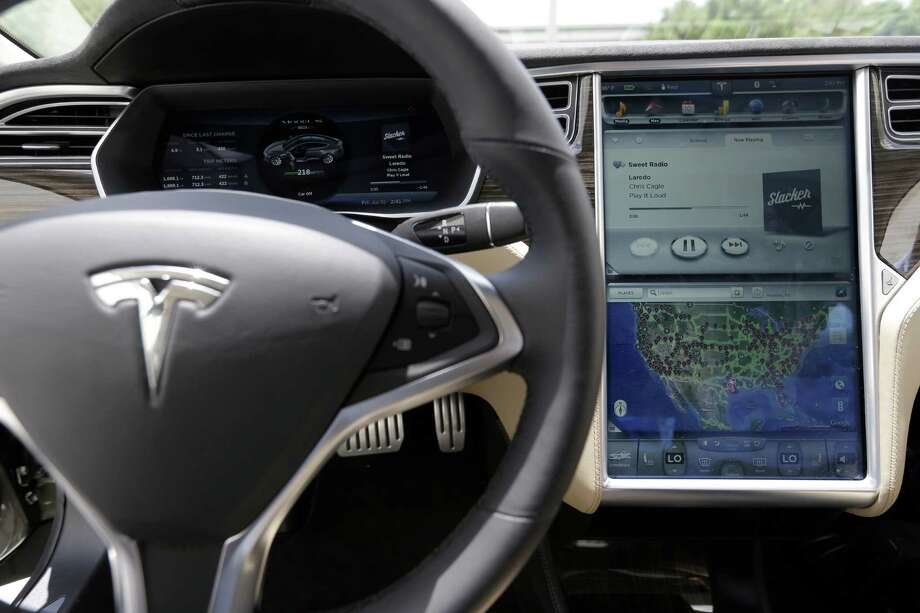 The Tesla Model S dash features a 17 inch touch screen shown at the Tesla Gallery and Service Center, 14820 North Freeway, Friday, July 10, 2015, in Houston. ( Melissa Phillip / Houston Chronicle ) Photo: Melissa Phillip, Staff / © 2015  Houston Chronicle