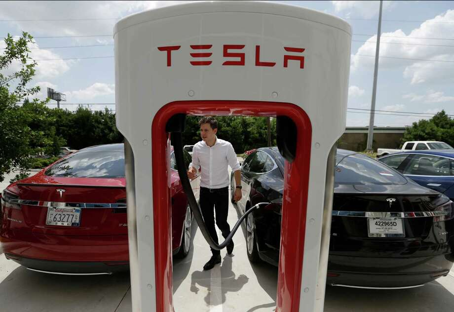 Tesla spokesman Karl Berridge says Tesla's galleries are meant to show the car company's technology to anyone who is interested. Photo: Melissa Phillip, Staff / © 2015  Houston Chronicle