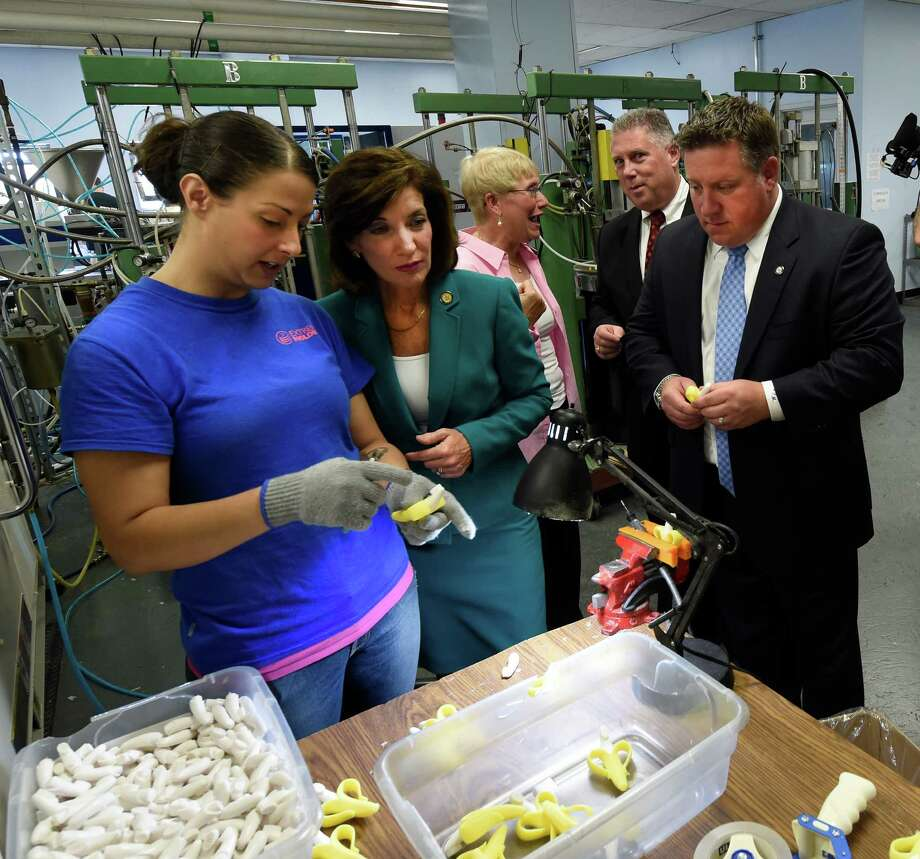Lt. Governor Kathy Hochul, center, speaks with an employee of Extreme Molding, a women owned business that operates as part of the Watervliet Arsenal Business & Technology Partnership Friday afternoon July 10, 2015 in Watervliet, N.Y.   Joining the Lt. Governor is Albany County Executive Dan McCoy, right and Assemblyman John McDonald, second from right in background.  (Skip Dickstein/Times Union) Photo: SKIP DICKSTEIN / 00032567A