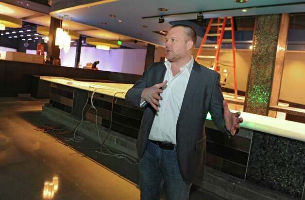 Brent Brown, the CEO of luxury bowling alley Latitude 360, talks about the progress of Latitude 360 in Crossgates Mall on Thursday, March 19, 2015 in Guilderland, N.Y. (Lori Van Buren / Times Union) ORG XMIT: MER2015071016573985 Photo: Lori Van Buren / 00031037A