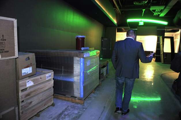 Brent Brown, the CEO of luxury bowling alley Latitude 360, walks through the arcade area as he shows the progress of Latitude 360 in Crossgates Mall on Thursday, March 19, 2015 in Guilderland, N.Y. (Lori Van Buren / Times Union) ORG XMIT: MER2015071016592598 Photo: Lori Van Buren / 00031037A