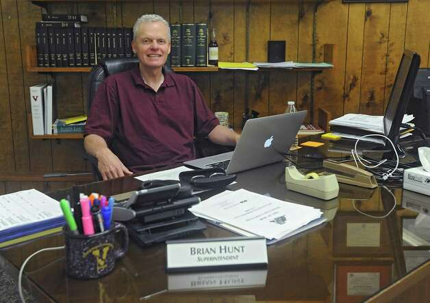 New Voorheesville School Superintendent Brian Hunt sits at his desk in the district offices in Voorheesville High School on Thursday, July 9, 2015 in Voorheesville, N.Y.  (Lori Van Buren / Times Union) Photo: Lori Van Buren / 00032536A