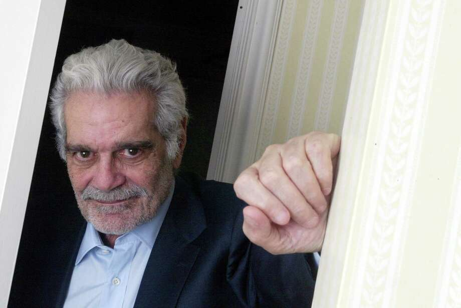 "FILE-- Egyptian actor Omar Sharif at the Essex House Hotel in New York, Nov. 18, 2003. Sharif, who rode out of the sands of the Sahara in the 1962 screen epic ""Lawrence of Arabia"" into a glamorous, if brief, reign as an international star in films like ""Dr. Zhivago"" and ""The Night of the Generals,"" died in a Cairo hospital. He was 83. It was reported by his agent on July 10, 2015. (Suzanne DeChillo/The New York Times) ORG XMIT: XNYT21 Photo: SUZANNE DECHILLO / NYTNS"
