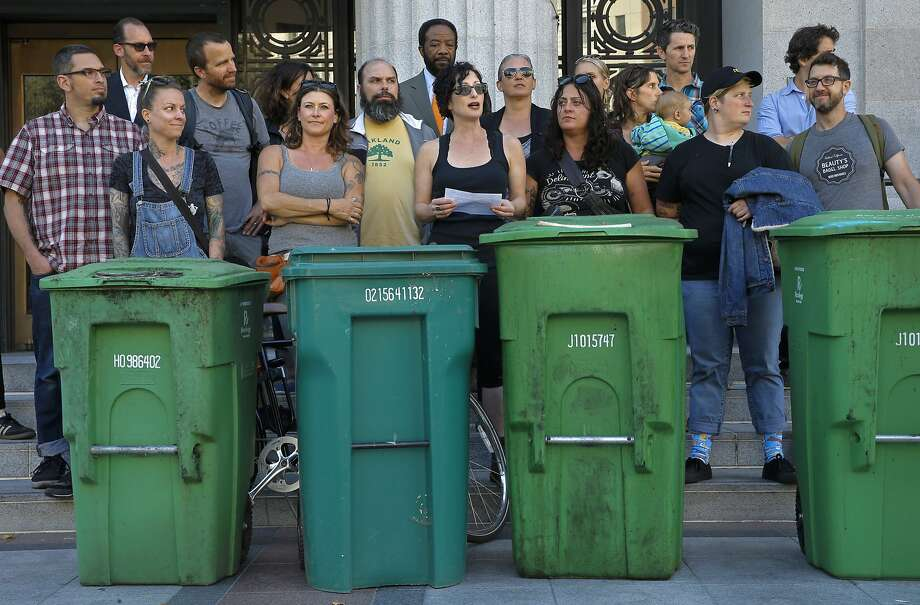 Gail Lillian, center, owner of Liba Falafel, gathered local restaurant owners and their compost bins on the the steps of City Hall in Oakland, Calif., to protest the increase of fees for compost and garbage pick up service as seen on Fri. July 10, 2015. Photo: Michael Macor, The Chronicle