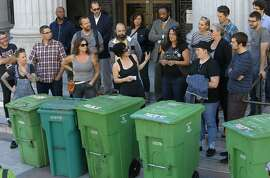 Gail Lillian, center owner of Liba Falafel gathered local restaurant owners and their compost bins on the the steps of City Hall in Oakland, Calif., to protest the increase of fees for compost and garbage pick up service as seen on Fri. July 10, 2015.