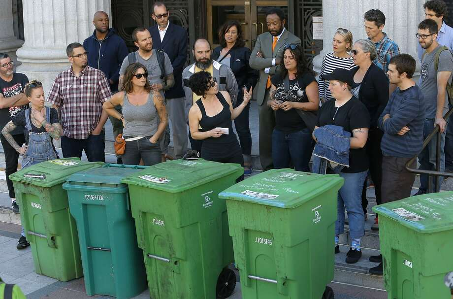Gail Lillian, center owner of Liba Falafel gathered local restaurant owners and their compost bins on the the steps of City Hall in Oakland, Calif., to protest the increase of fees for compost and garbage pick up service as seen on Fri. July 10, 2015. Photo: Michael Macor, The Chronicle