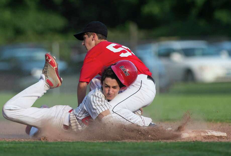 BancâÄôs Tyler Phillips gets caught leading off of second base and is tagged out by the Redmen shortstop Andrew D'Autillio during the Greenwich Senior Babe Ruth championship game played at Julian Curtiss field, Greenwich, CT on Friday, July 10, 2015 Photo: Mark Conrad / For Hearst Connecticut Media / Connecticut Post Freelance