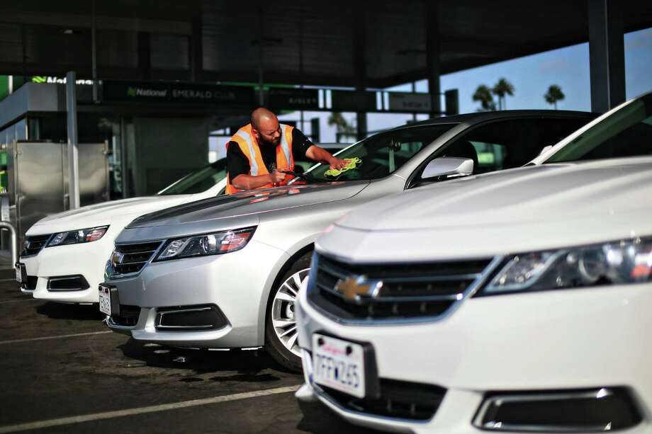 Chevrolet Impalas sit on the lot at a National Car Rental in San Diego. Many of those who opt for expensive protection at the rental counter are unaware that their own auto insurance may cover them while driving a rental. Photo: Sandy Huffaker /New York Times / NYTNS