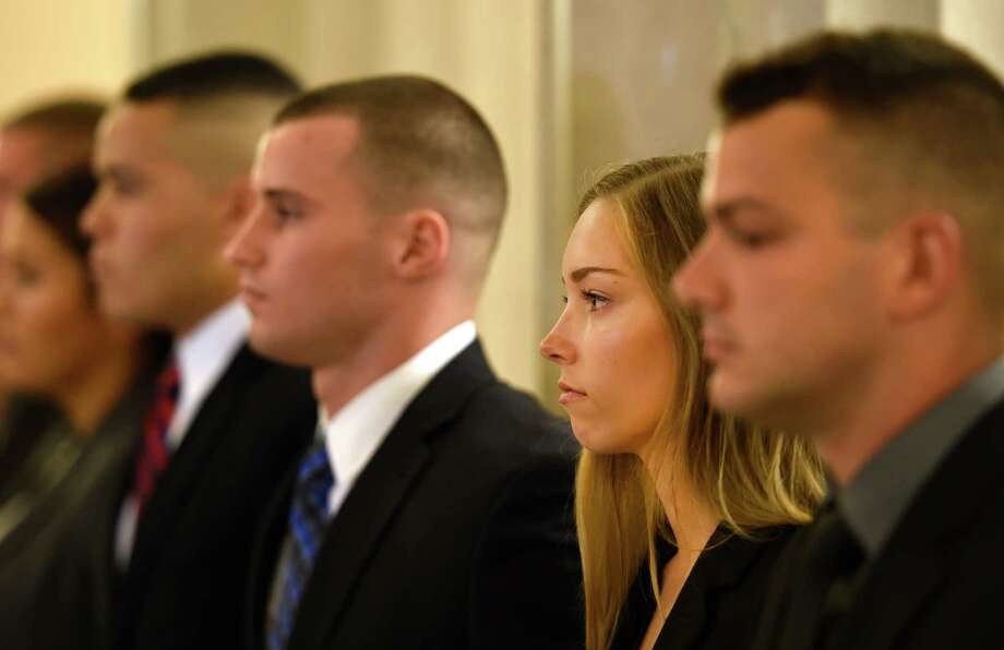 Taylor Carey, second from right stands at attention with 13 other new Albany County Sheriff's deputies which were sworn Friday morning in the Albany County Courthouse July 10, 2015 in Albany, N.Y.   (Skip Dickstein/Times Union) Photo: SKIP DICKSTEIN / 00032569A