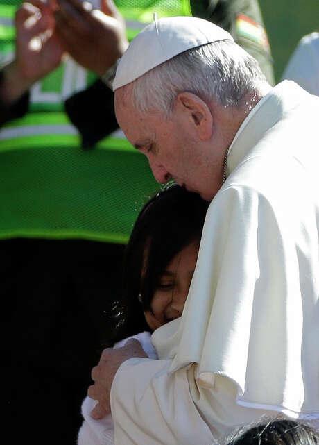Francis hugs a child as he meets with prisoners inside Palmasola. Photo: Gregorio Borgia / Associated Press / AP