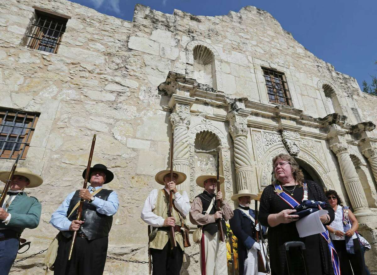 Daughters of the Republic of Texas president general Dr. Betty Joe Edwards holds American and Texas flags that were flown at the Alamo on July 10, 2015, after a ceremony ending the DRT's 110-year custodianship of the Shrine of Texas Liberty.