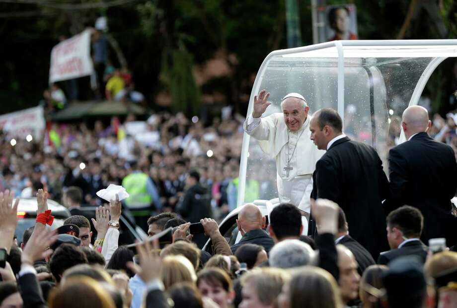 Pope Francis greets the crowd as he leaves the women's prison Buen Pastor's chorus in Asuncion, Paraguay, Friday, July 10, 2015. The Paraguay government declared Friday and Saturday national holidays in honor of the pope's visit. (AP Photo/Jorge Saenz) Photo: Jorge Saenz, STF / AP