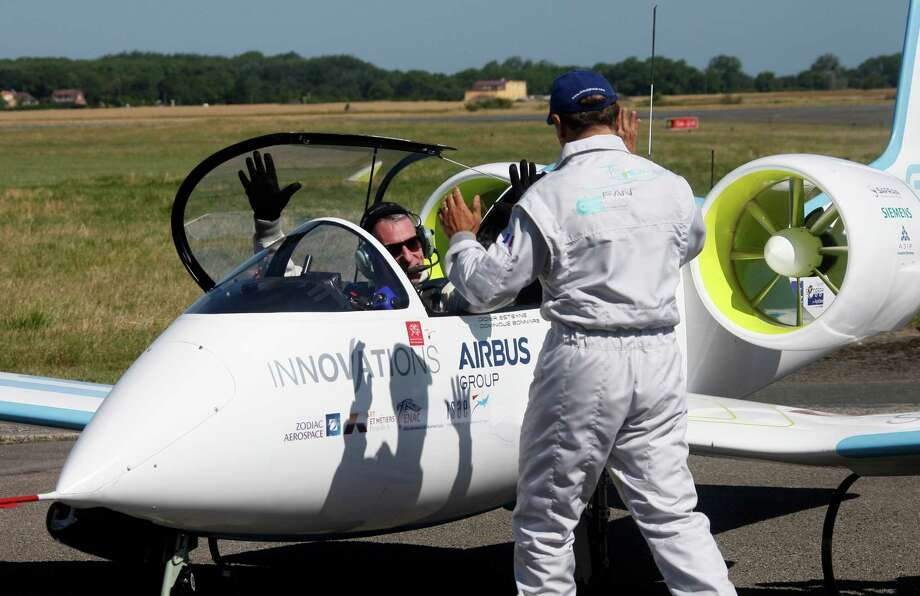 Pilot Didier Esteyne enjoys the moment on Friday in Calais, France, after crossing the English Channel with his Airbus E-Fan prototype. It was a symbolically important step toward making battery-powered flight viable. , Photo: Michel Spingler, STR / AP