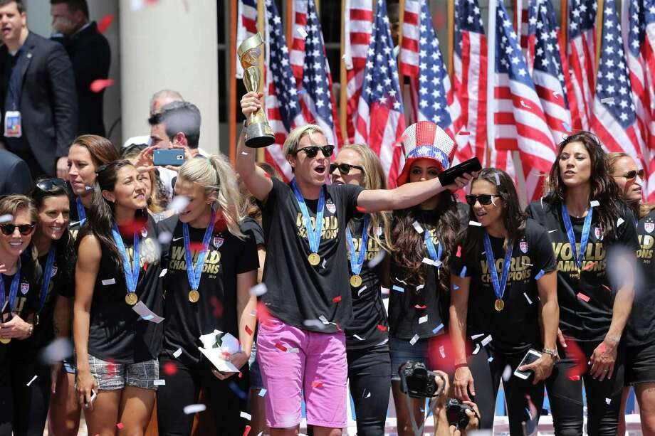 Abby Wambach celebrates with the World Cup trophy and a key to the city of New York, with other members of the U.S. women's soccer team outside City Hall, July 10, 2015. (Richard Perry/The New York Times) ORG XMIT: XNYT65 Photo: RICHARD PERRY / NYTNS