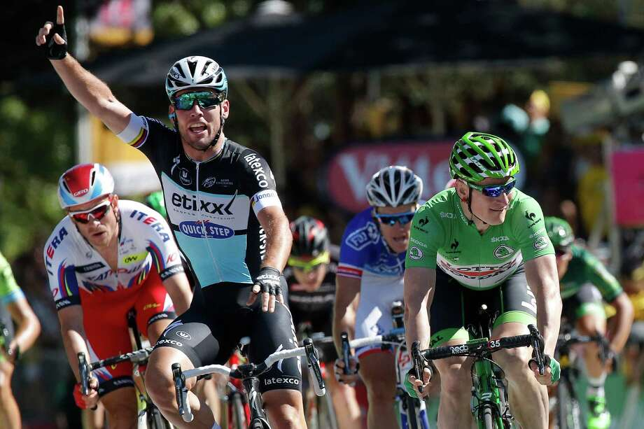 Mark Cavendish of Britain celebrates as he crosses the finish line to win Friday's seventh stage of the Tour de France. Photo: Laurent Cipriani, STR / AP
