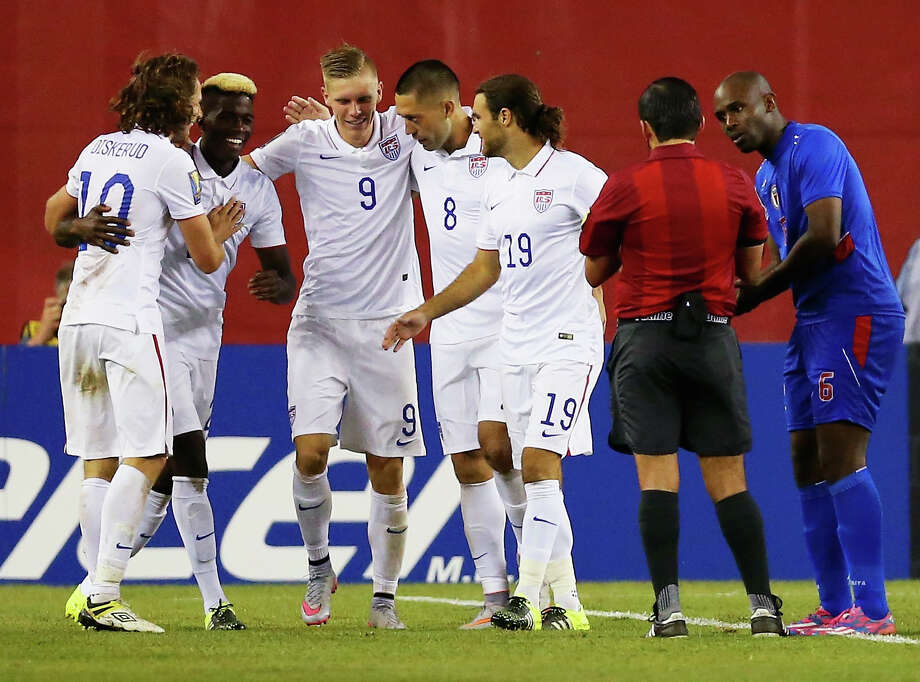 Teammates congratulate Clint Dempsey (No. 8) after he scored the winning goal in a 1-0 victory over Haiti. Meanwhile, Frantz Bertin of Haiti, right, disputes the goal that came in the 47th minute. Photo: Maddie Meyer, Staff / 2015 Getty Images