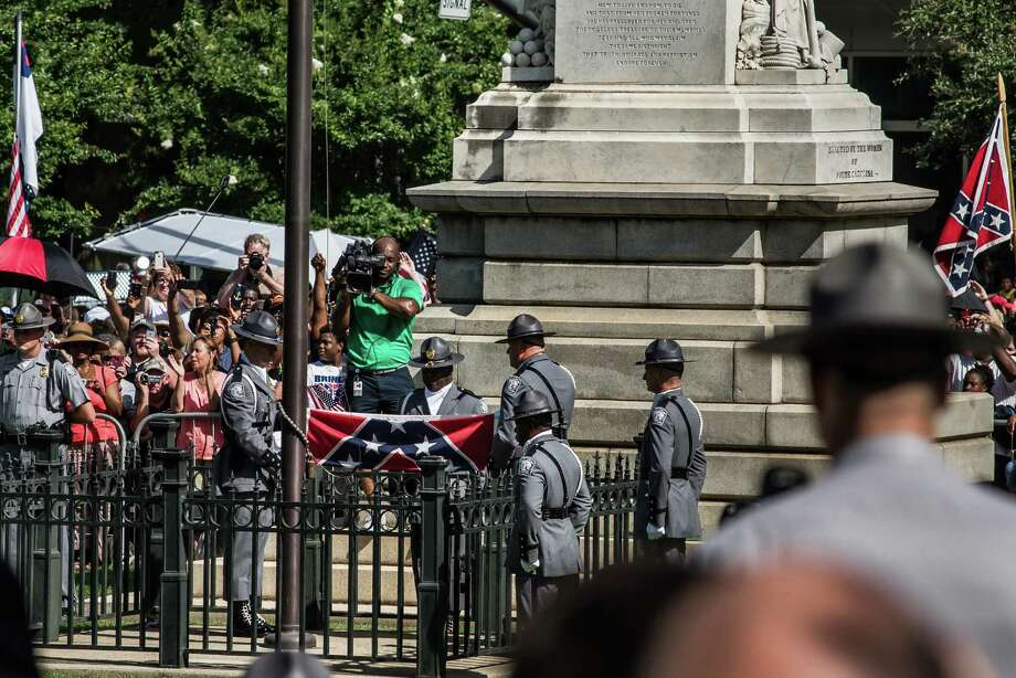 A Highway Patrol honor guard removes the Confederate flag outside the South Carolina State House. Photo: Sean Rayford / Getty Images / 2015 Getty Images