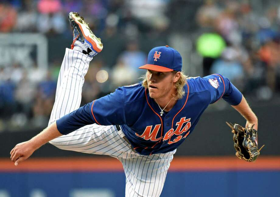New York Mets pitcher Noah Syndergaard delivers the ball to the Arizona Diamondbacks during the first inning of a baseball game Friday, July 10, 2015, in New York. (AP Photo/Bill Kostroun) ORG XMIT: NYM103 Photo: Bill Kostroun / FR51951 AP