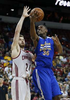 Golden State Warriors' Kevon Looney, right, goes up for a shot against Cleveland Cavaliers' John Shurna during the first half of an NBA summer league basketball game Friday, July 10, 2015, in Las Vegas. (AP Photo/John Locher)