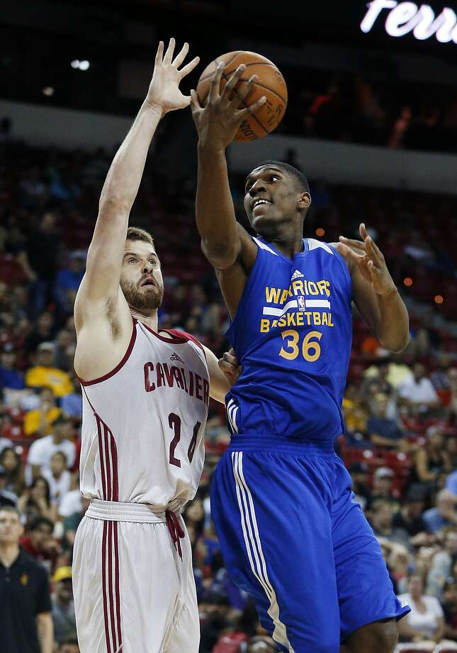 Golden State Warriors' Kevon Looney, right, goes up for a shot against Cleveland Cavaliers' John Shurna during the first half of an NBA summer league basketball game Friday, July 10, 2015, in Las Vegas. (AP Photo/John Locher) Photo: John Locher, Associated Press