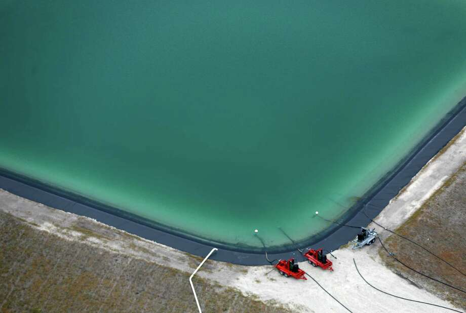 This water retention pond is in the Eagle Ford Shale region between Karnes City and Falls City. A University of Texas study says despite the billions of gallons used, the effects are relatively small. Photo: William Luther, Staff / © 2013 San Antonio Express-News
