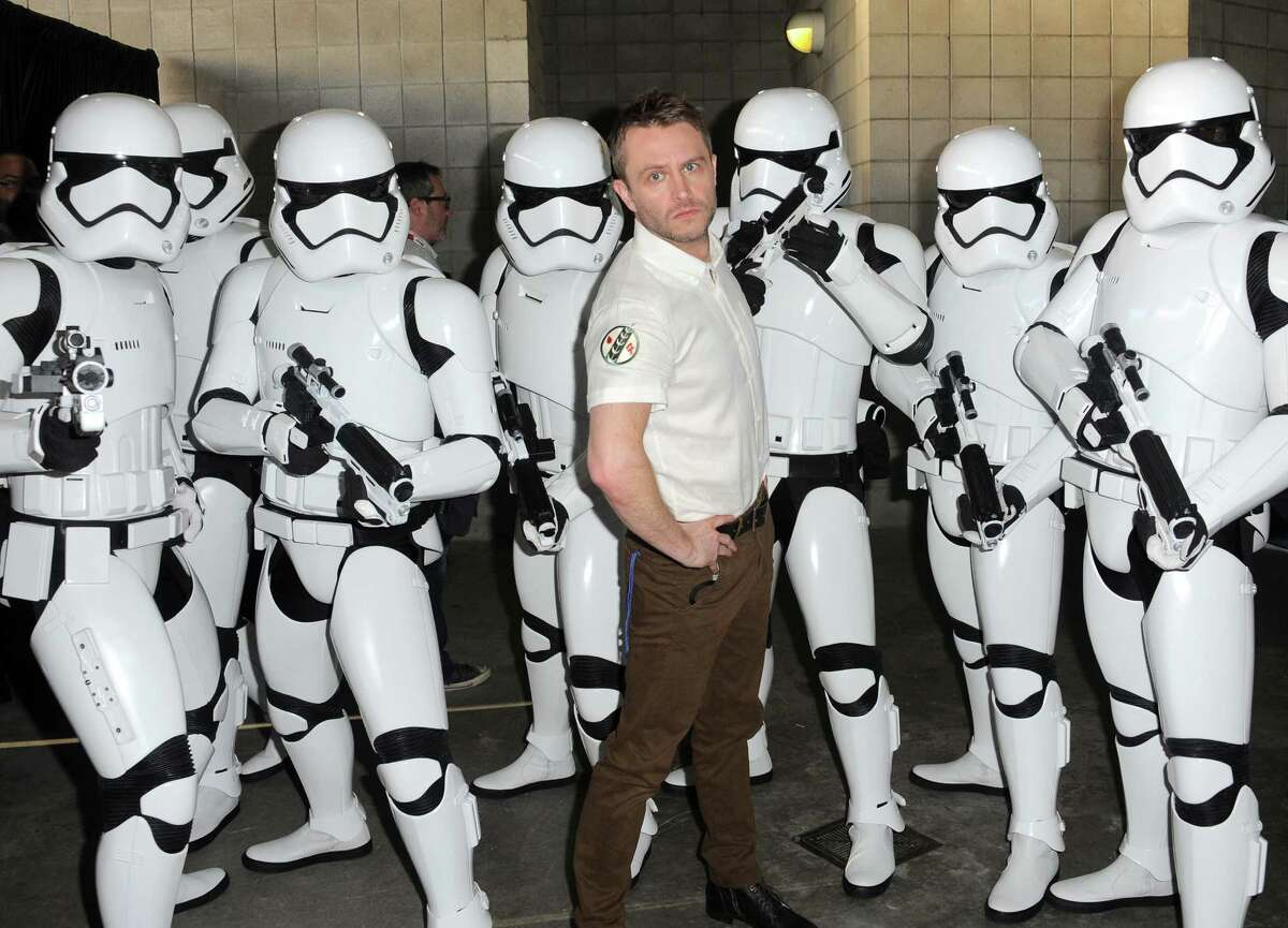 TV host Chris Hardwick (C) poses with Stormtroopers backstage.