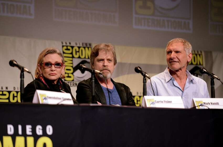 (L-R) Actress Carrie Fisher, actor Mark Hamill and actor Harrison Ford speak onstage at the Lucasfilm panel during Comic-Con International 2015 at the San Diego Convention Center on July 10, 2015 in San Diego, California.