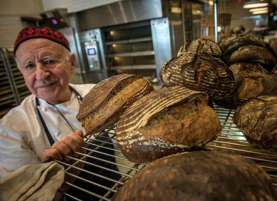 """Mark Furstenberg has a zero-tolerance policy for """"campers"""" during busy periods at Bread Furst. """"It's not your workspace,"""" he tells them.  Photo: Bill O'Leary, STF / The Washington Post"""