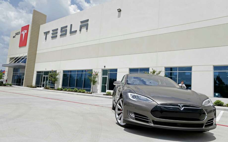 A Tesla Model S is shown at the Tesla Gallery and Service Center, 14820 North Freeway, Friday, July 10, 2015, in Houston. Photo: Melissa Phillip, Houston Chronicle / © 2015  Houston Chronicle