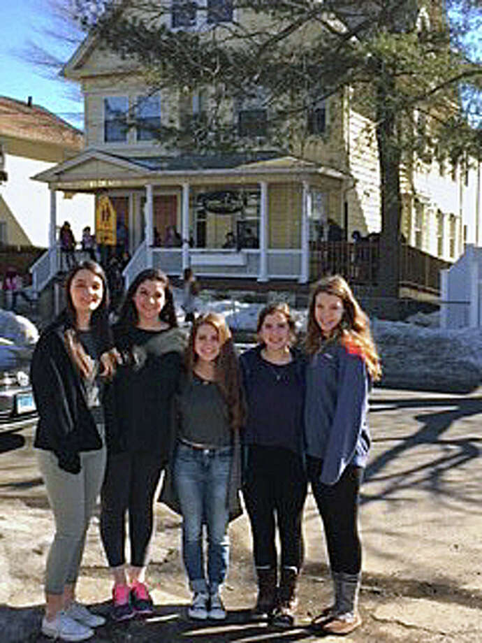 Members of the Caroline House Club, from Fairfield Ludlowe High School, stand outside the non-profit's home in Bridgeport prior to a recent tutoring session. Photo: Contributed Photo / Fairfield Citizen /  Fairfield Citizen contributed