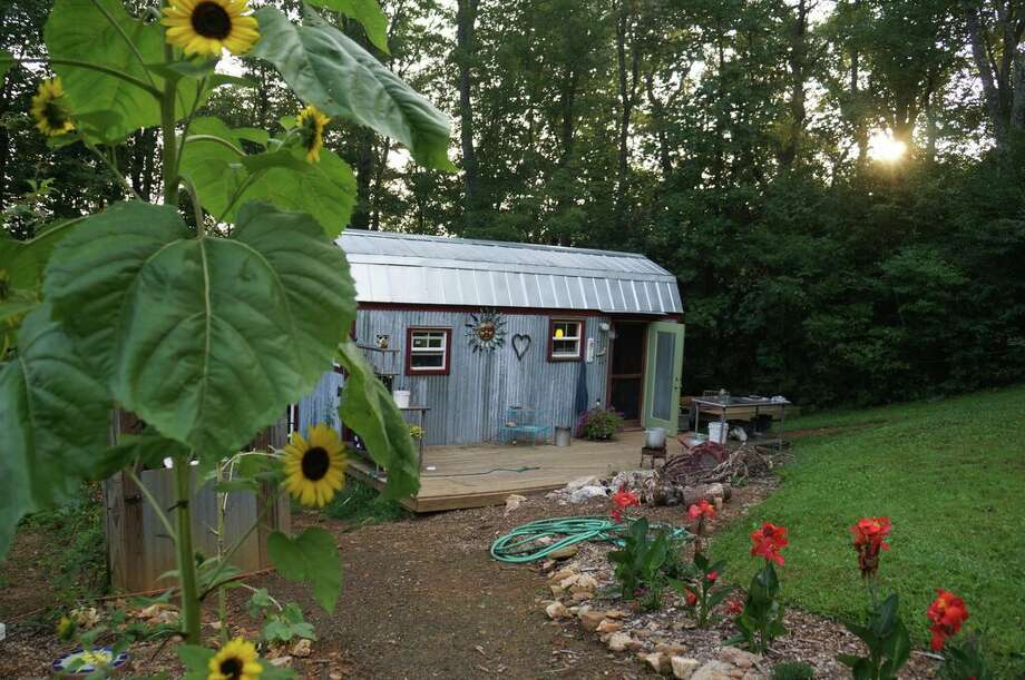 The Berzins family's 168-square-foot home on a three-acre plot in Virginia's Blue Ridge Mountains. Photo: Tiny House Family