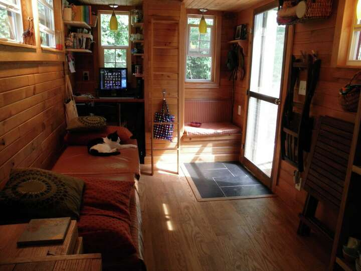A ladder in the living area takes you to the loft and for Tiny house with 2 sleeping lofts