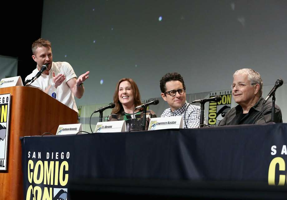 "Television host and actor Chris Hardwick (left) moderates a panel with ""Star Wars: The Force Awakens"" producer Kathleen Kennedy, director J.J. Abrams and screenwriter Lawrence Kasdan during Comic-Con International 2015 in San Diego in July. Kasdan, who co-wrote ""The Empire Strikes Back"" and ""Return of the Jedi,"" was persuaded to return to the franchise to write a movie on his favorite char acter, Han Solo.  The film ""honors our goals,"" he says. Photo: Jesse Grant, Getty Images For Disney"