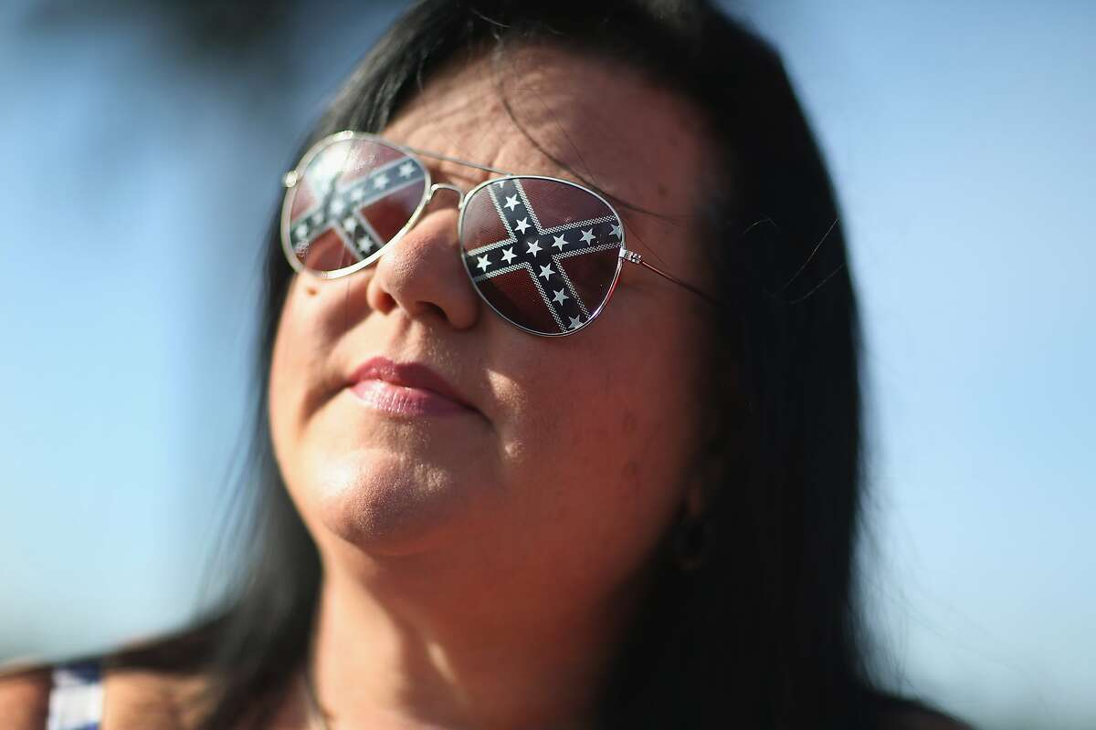 LOXAHATCHEE, FL - JULY 11: Anitra Carrano wears Confederate flag sunglasses as she participates in a rally to show support for the American and Confederate flags on July 11, 2015 in Loxahatchee, Florida. Organizers of the rally said that after the Confederate flag was removed from South Carolinas State House it reinforced their need to show support for the Confederate flag which some feel is under attack. (Photo by Joe Raedle/Getty Images)