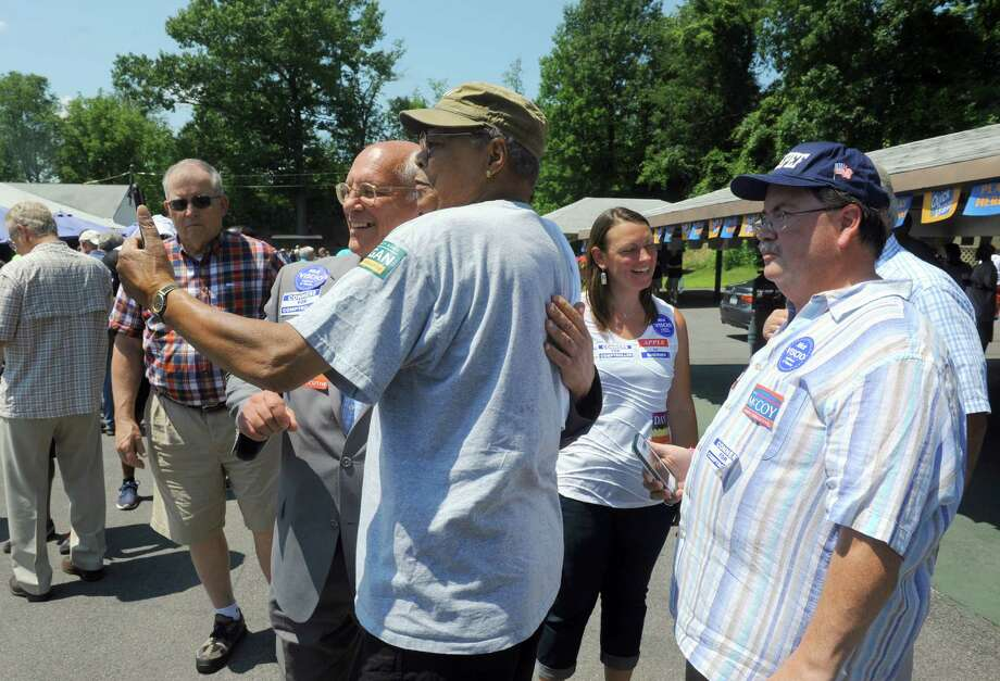 Congressman Paul Tonko, center, gets his photograph taken with Ron Scott of Albany during the Albany Democratic Picnic at Lanthier's Grove on Saturday July 11, 2015 in Cohoes, N.Y. (Michael P. Farrell/Times Union) Photo: Michael P. Farrell / 00032571A