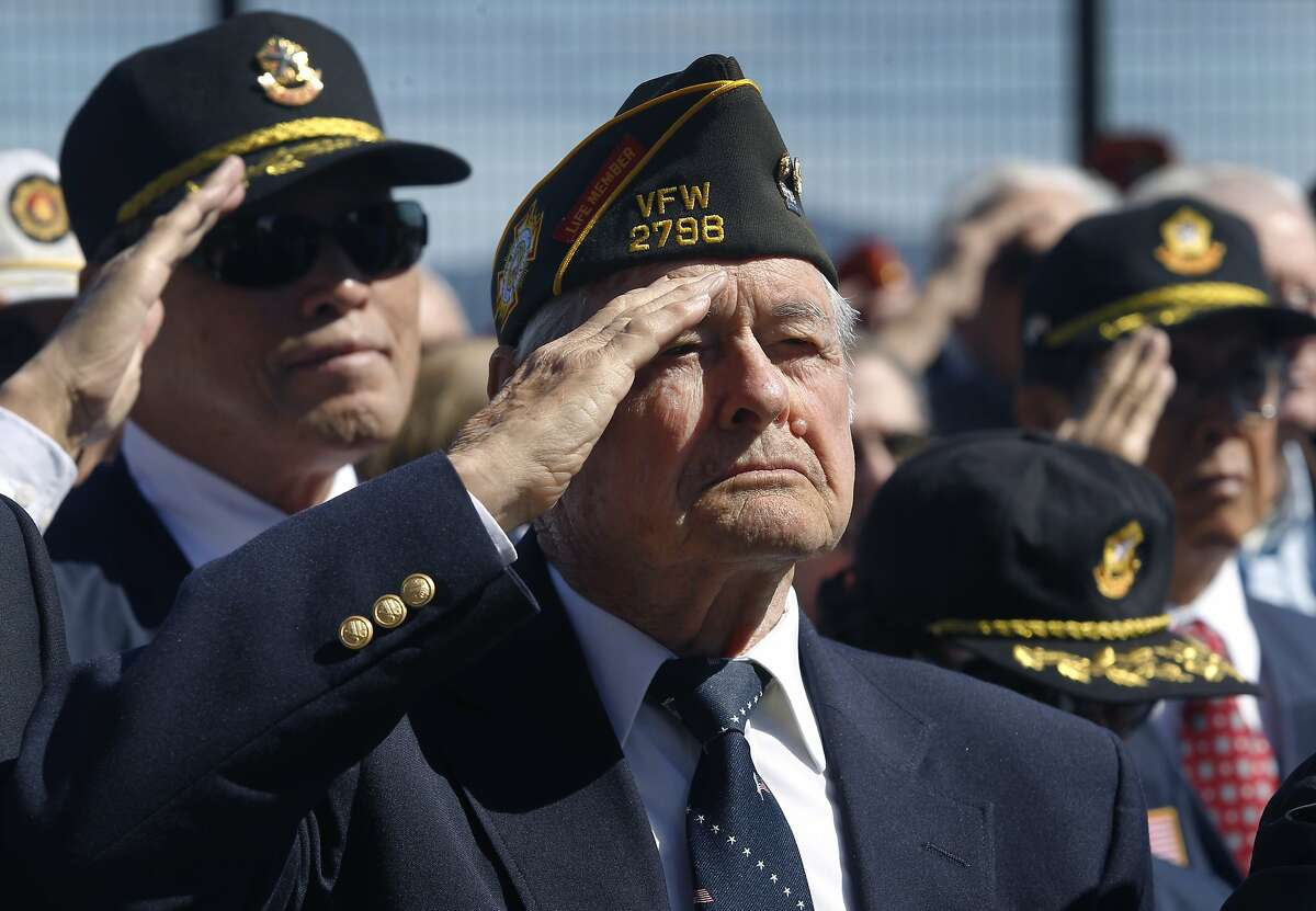 Retired Navy Lt. Cmdr. Carl Petersdorf salutes while the national anthem is played at a groundbreaking ceremony for a Korean War Memorial at the Presidio National Cemetery in San Francisco, Calif. on Saturday, July 11, 2015.