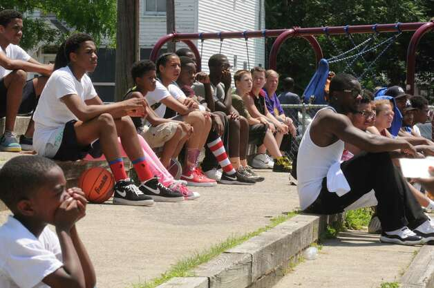 A crowd watches the Schenectady community police basketball game at Jerry Burrell Park on Saturday July 11, 2015 in Schenectady, N.Y. (Michael P. Farrell/Times Union) Photo: Michael P. Farrell / 00032579A