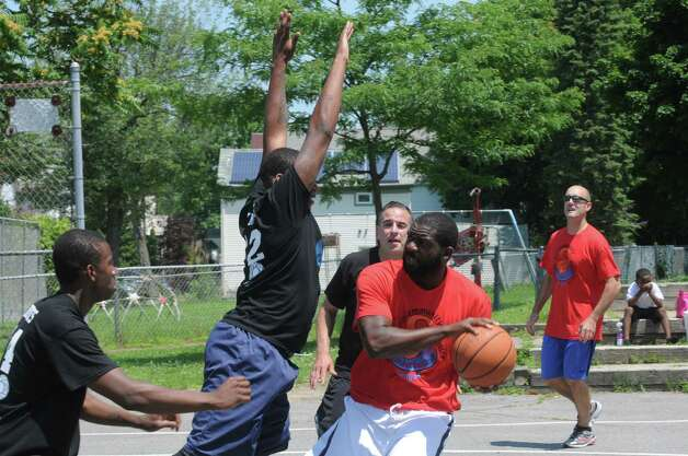 Players take part in the Schenectady community police basketball game at Jerry Burrell Park on Saturday July 11, 2015 in Schenectady, N.Y. (Michael P. Farrell/Times Union) Photo: Michael P. Farrell / 00032579A