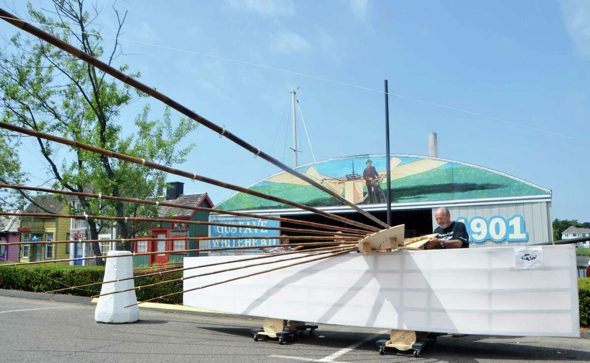 Andy Kosch, of Fairfield, shows off his progress on the new Whitehead Flyer he's building at Captain's Cove.