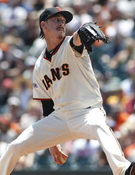San Francisco Giants pitcher Tim Lincecum throws to the Colorado Rockies during the first inning of a baseball game, Saturday, June 27, 2015, in San Francisco. (AP Photo/George Nikitin)