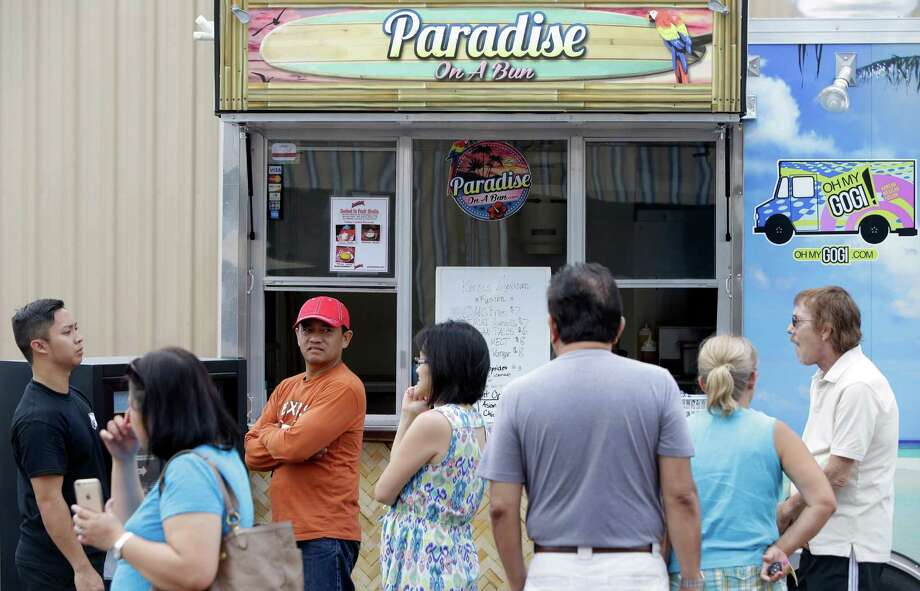 People are shown at Paradise On A Bun food truck at Bernie's Backyard, 22314 I-45 North, Saturday, July 11, 2015, in Spring.  The new food truck park includes a main dining room, bar area and climate controlled patio. Photo: Melissa Phillip, Houston Chronicle / © 2015  Houston Chronicle