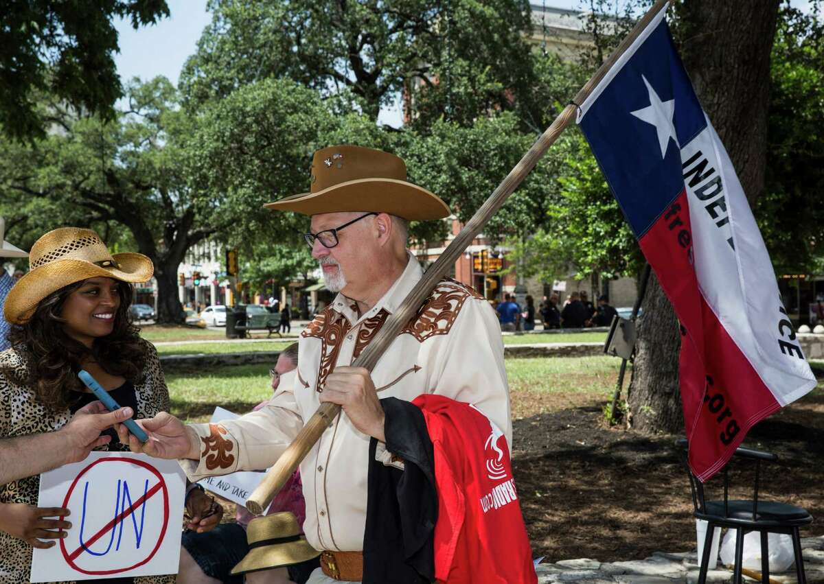 Pam Stevens and Doc Greene were among those who gathered at Alamo Plaza for a protest organized against the Alamo's recent designation as a World Heritage Site by United Nations Educational, Scientific and Cultural Organization, or UNESCO.