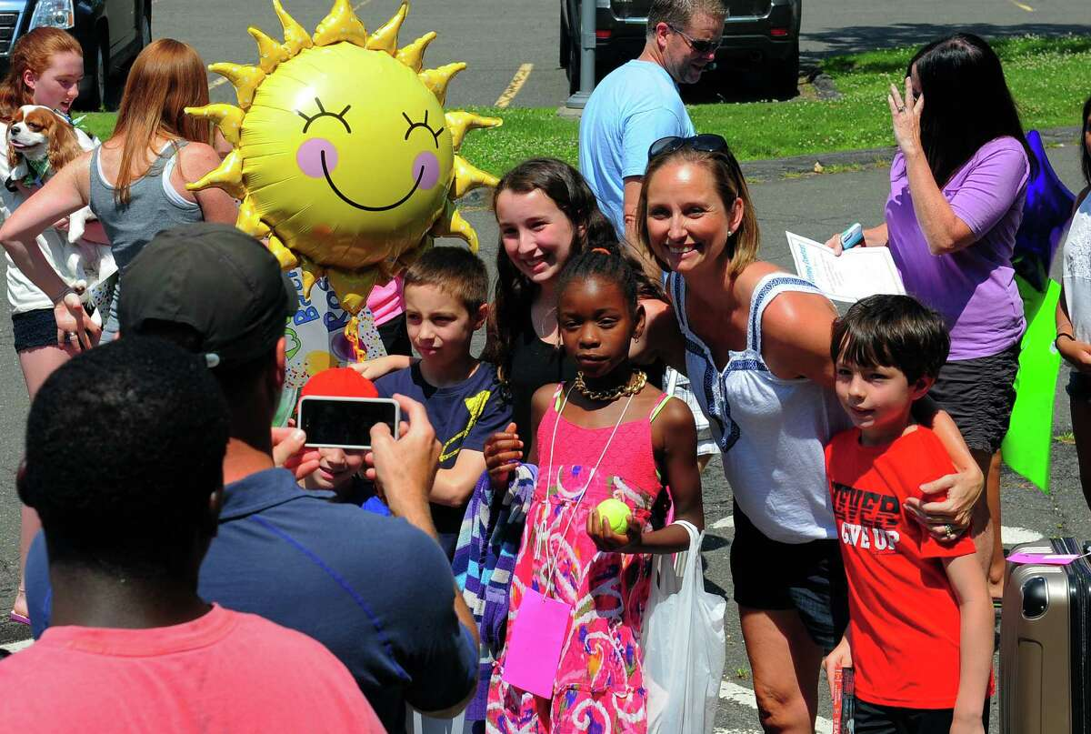 Kids from the Fresh Air Fund program arrive to join their host families at Roger Ludlowe Middle School in Fairfield, Conn., on Saturday July 11, 2015. The Fresh Air Fund program gives city kids a chance to experience the country in summer by staying with a host family.