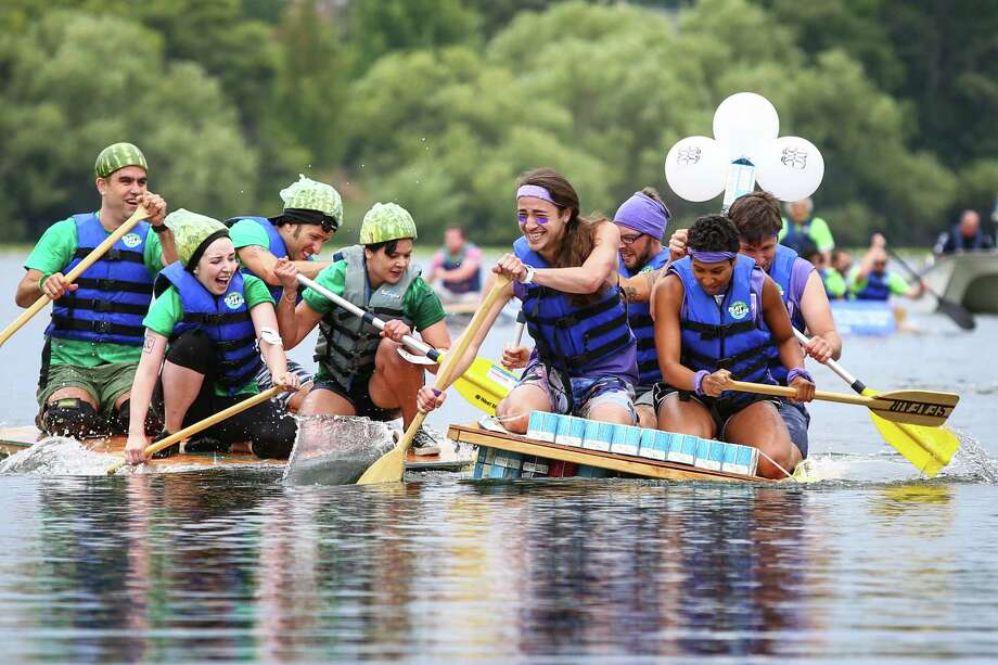 Boats collide in a race during the 45th annual Seafair Milk Carton Derby at Green Lake on Saturday, July 11, 2015. Dozens of boats competed for bragging rights in the annual Seafair competition. Photo: JOSHUA TRUJILLO, SEATTLEPI.COM / SEATTLEPI.COM
