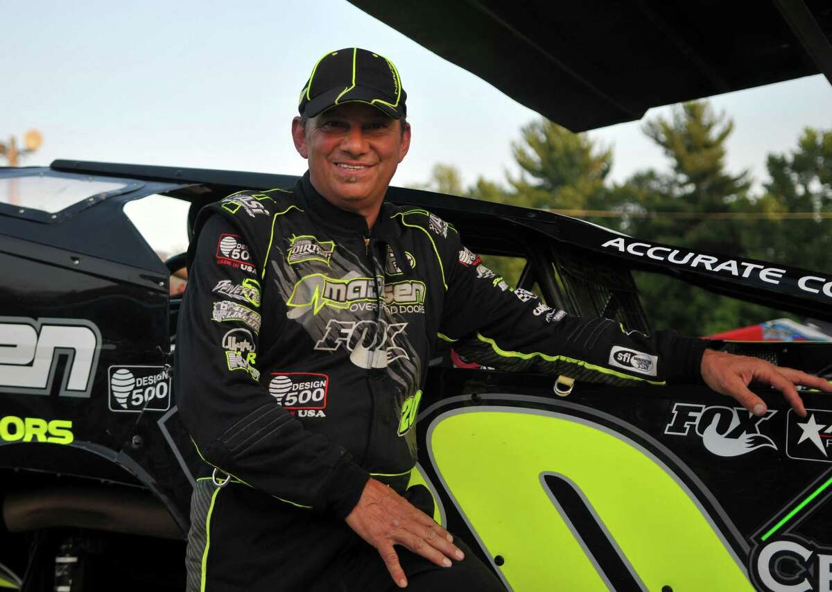 Brett Hearn stands next to his car for a portrait Friday, July 10, 2015, at Albany Saratoga Speedway in Ballston Spa, N.Y. (Phoebe Sheehan/Special to The Times Union)