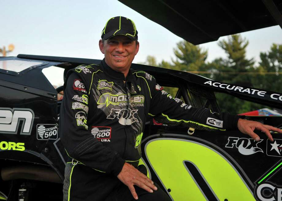 Brett Hearn stands next to his car for a portrait Friday, July 10, 2015, at Albany Saratoga Speedway in Ballston Spa, N.Y. (Phoebe Sheehan/Special to The Times Union) Photo: PS / 00032509A