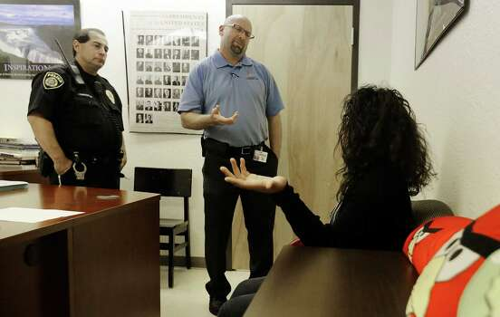 Northeast Independent School District officer Juan Dominguez (left) and Assistant Principal Kevin Curtis meet with a student involved in fight between two other students in the halls of Ed White Middle School on Wednesday, May 20, 2015. The middle school has been part of a three-year pilot program utilizing restorative discipline techniques to stem issues such as physical altercations between students and to promote communication between educators and students in order to raise academic standards. (Kin Man Hui/San Antonio Express-News) Photo: Kin Man Hui, Staff / San Antonio Express-News / ©2015 San Antonio Express-News