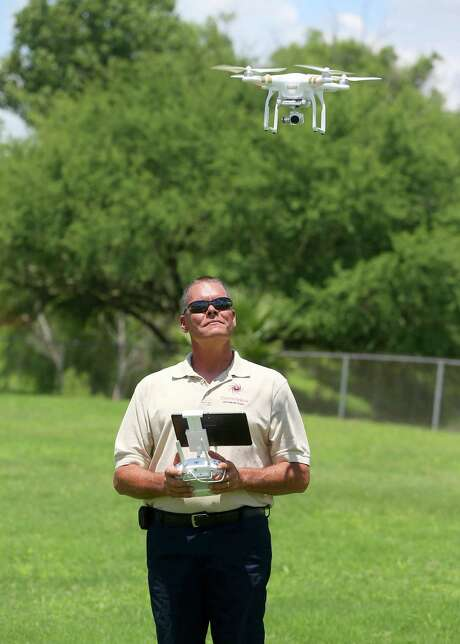 Steve Combs, who operates Droneview LLC, flies one of his crafts. He's one of the several hundred people nationally who have received exemptions to operate drones commercially. Photo: William Luther / San Antonio Express-News / © 2015 San Antonio Express-News